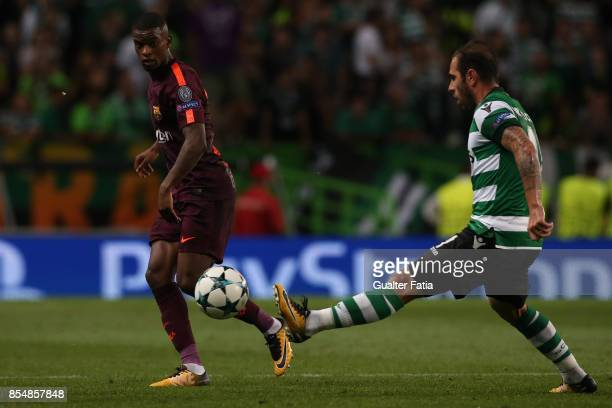 Barcelona defender Nelson Semedo from Portugal with Sporting CP midfielder Bruno Cesar from Brazil in action during the UEFA Champions League match...