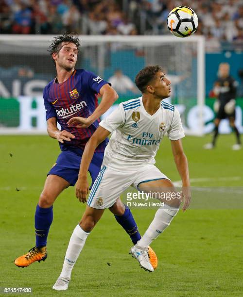 Barcelona defender Sergi Roberto battles for a loose ball with Real Madrid forward Achraf Hakimi during the second half of the ''El Clasico Miami''...