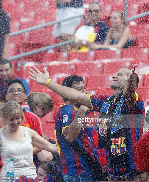 FC Barcelona fan gets some relief from the heat prior to the World Football Challenge Friendly match between FC Barcelona and Manchester United...