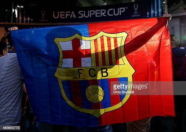Barcelona fan holds up a flag outside the stadium ahead of the UEFA Super Cup match between Barcelona and Sevilla FC at Dinamo Stadium on August 11...