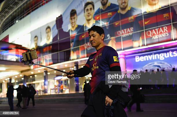 Barcelona fan takes a selfie prior to the UEFA Champions League Group E match between FC Barcelona and AS Roma at Camp Nou on November 24 2015 in...