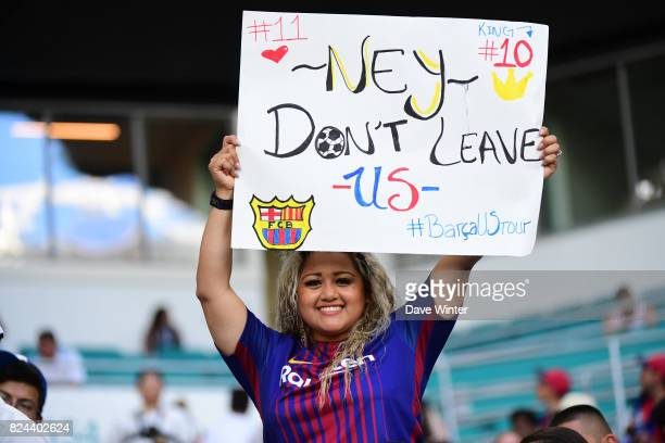 A Barcelona fan with a banner begging Neymar Jr of Barcelona to stay at the club during the International Champions Cup match between Barcelona and...