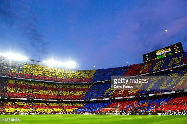Barcelona fans cheer on their team prior to the Copa del Rey Final match between FC Barcelona and Athletic Club at Camp Nou on May 30 2015 in...