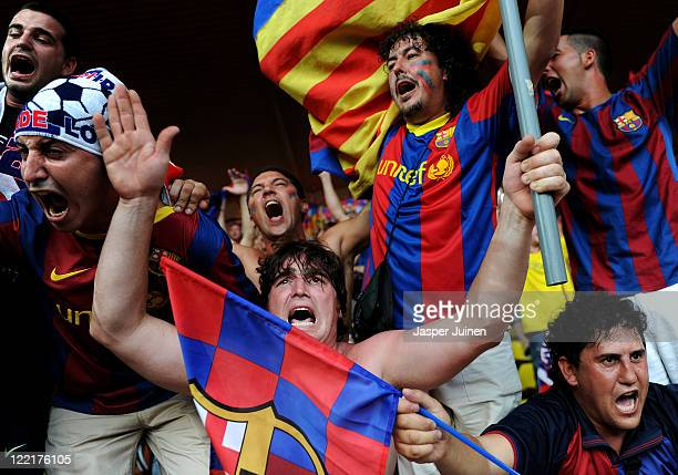 Barcelona fans cheer prior to the start of the UEFA Super Cup match between FC Barcelona and FC Porto at Louis II Stadium on August 26 2011 in Monaco...