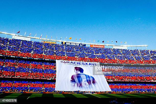Barcelona fans display a huge banner tribute to Xavi Hernanez prior to the La Liga match between FC Barcelona and RC Deportivo de la Coruna at Camp...