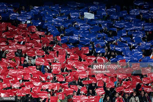 Barcelona fans hold placards in the color of their club at the start of the La Liga match between Barcelona and Real Madrid at the Camp Nou Stadium...