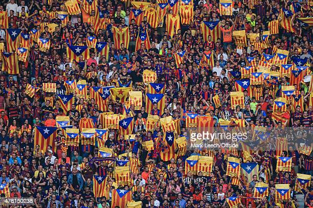 Barcelona fans hold proCatalan independence flags known as the 'Estelada' during the UEFA Champions League Final between Juventus and FC Barcelona at...