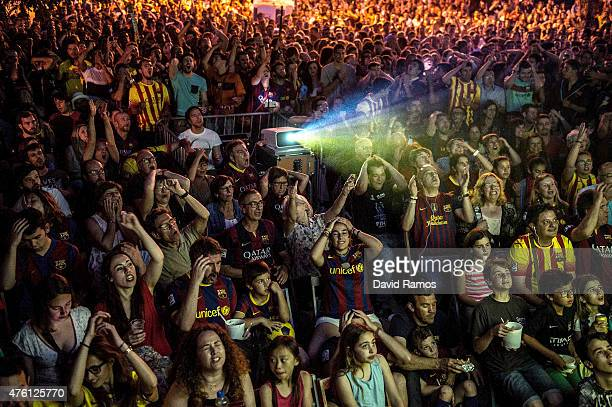 Barcelona fans watch the UEFA Champions League Final match on a big screen on June 6 2015 in Barcelona Spain