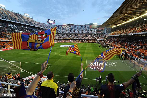 Barcelona fans wave flags ahead of the Copa del Rey Final between Real Madrid and Barcelona at Estadio Mestalla on April 16 2014 in Valencia Spain