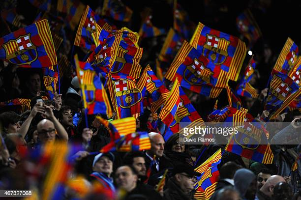 Barcelona fans wave flags during the UEFA Champions League round of 16 second leg match between FC Barcelona and Manchester City at the Camp Nou...