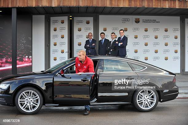Barcelona Football Club player Jeremy Mathieu receives the keys of the new Audi cars during the presentation of Barcelona Football Club's new cars...