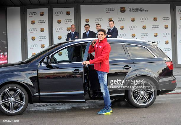 Barcelona Football Club player Marc Bartra receives the keys of the new Audi cars during the presentation of Barcelona Football Club's new cars made...