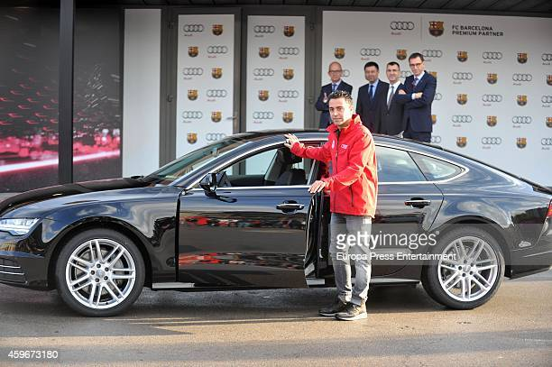 Barcelona Football Club player Xavi Hernandez receives the keys of the new Audi cars during the presentation of Barcelona Football Club's new cars...
