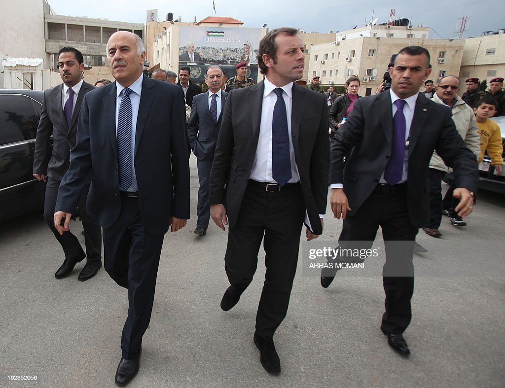 FC Barcelona football club's president Sandro Rosell (C) and Palestinian Football Association chairman Jibril Rajoub (L) arrive in the West bank city of Ramallah to give press conference on February 22, 2013. Rosell is visiting to promote a football match between Israel and the Palestinians with players from both sides of the conflict as a step towards Middle East peace.