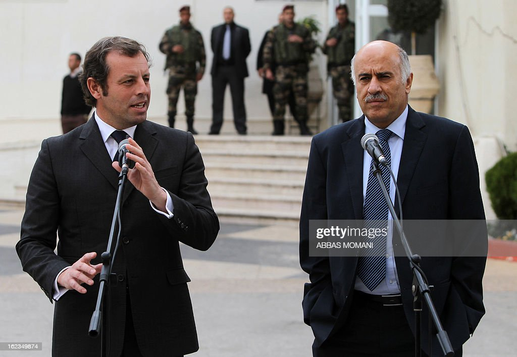 FC Barcelona football club's president Sandro Rosell (L) gives a joint press conference with Palestinian Football Association chairman Jibril Rajoub (R) in the West bank city of Ramallah, on February 22, 2013. Rosell is visiting to promote a football match between Israel and the Palestinians with players from both sides of the conflict as a step towards Middle East peace. AFP PHOTO/ABBAS MOMANI