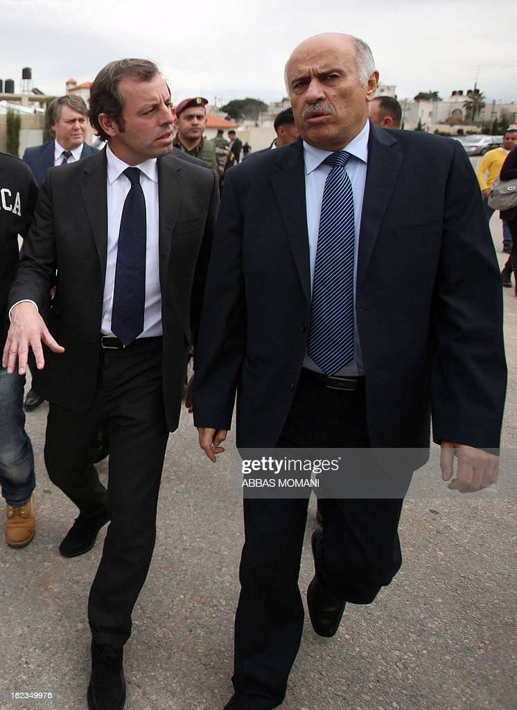 FC Barcelona football club's president Sandro Rosell (L) walks with Palestinian Football Association chairman Jibril Rajoub (R) prior to giving a press conference in the West bank city of Ramallah, on February 22, 2013. Rosell is visiting to promote a football match between Israel and the Palestinians with players from both sides of the conflict as a step towards Middle East peace.