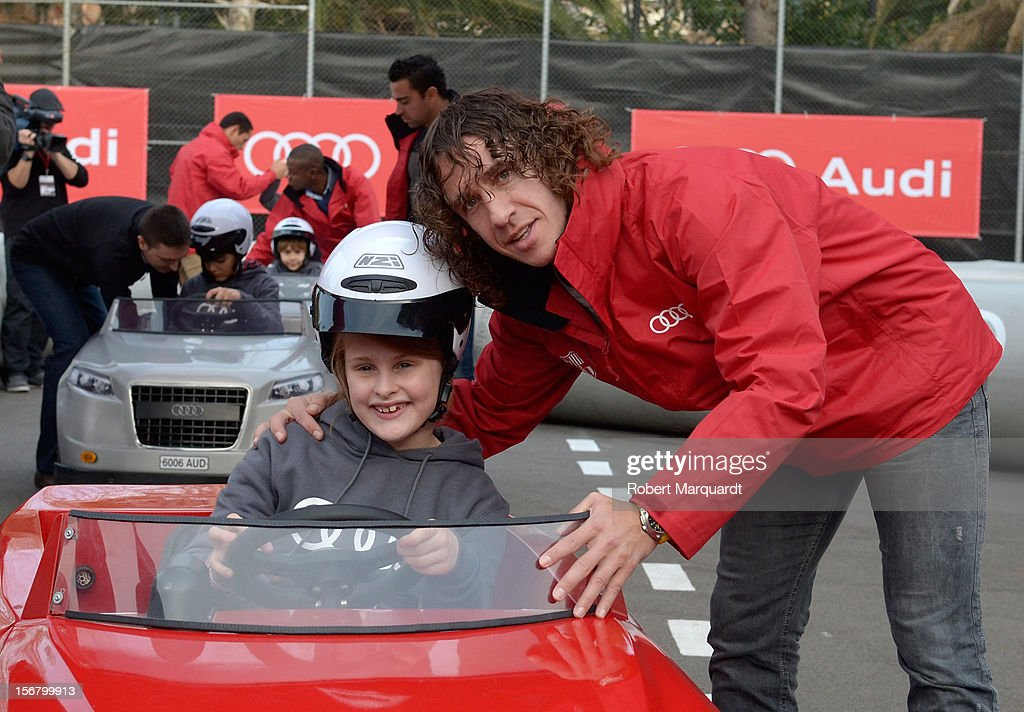 Barcelona football player <a gi-track='captionPersonalityLinkClicked' href=/galleries/search?phrase=Carles+Puyol&family=editorial&specificpeople=211383 ng-click='$event.stopPropagation()'>Carles Puyol</a> attends an Audi presentation during which Barcelona FC players received new Audi cars for the 2012-2013 season at Camp Nou on November 21, 2012 in Barcelona, Spain.