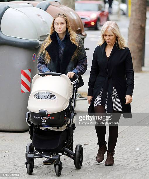 Barcelona football player Carles Puyol's girlfriend model Vanessa Lorenzo her mother and her newborn child Manuela are seen on February 9 2014 in...