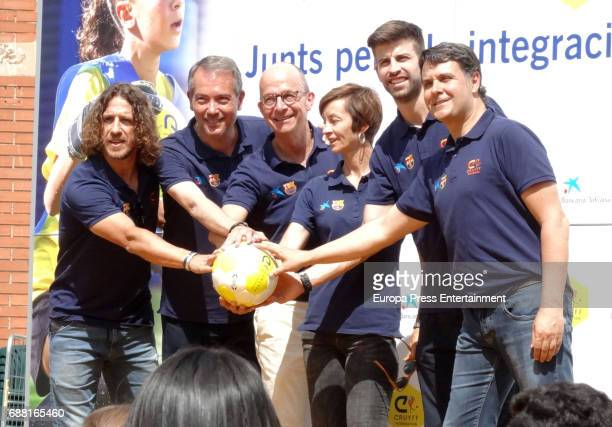 Barcelona football player Gerard Pique and Carles Puyol attend the opening of the Cruyff Court Gerard Pique on May 24 2017 in Sant Guim de Freixenet...