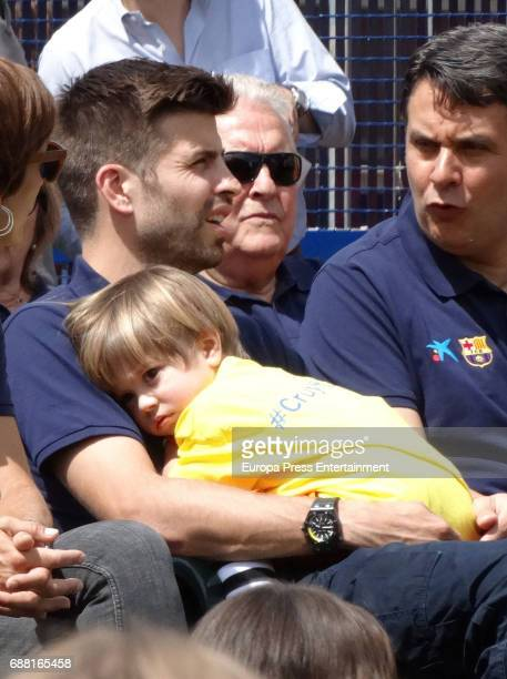 Barcelona football player Gerard Pique and his son Sacha Pique attend the opening of the Cruyff Court Gerard Pique on May 24 2017 in Sant Guim de...