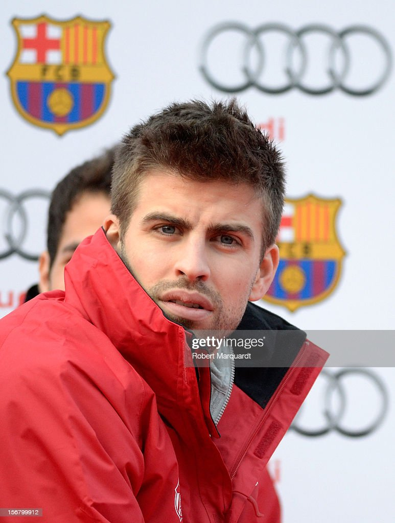 Barcelona football player <a gi-track='captionPersonalityLinkClicked' href=/galleries/search?phrase=Gerard+Pique&family=editorial&specificpeople=227191 ng-click='$event.stopPropagation()'>Gerard Pique</a> attends an Audi presentation during which Barcelona FC players received new Audi cars for the 2012-2013 season at Camp Nou on November 21, 2012 in Barcelona, Spain.
