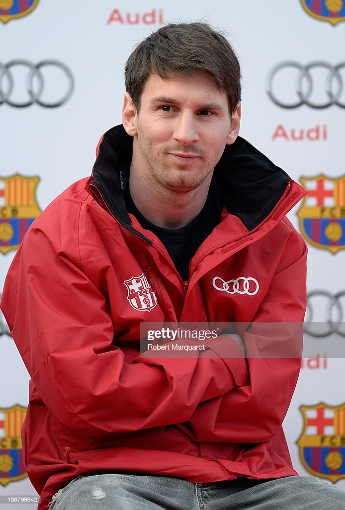Barcelona football player <a gi-track='captionPersonalityLinkClicked' href=/galleries/search?phrase=Lionel+Messi&family=editorial&specificpeople=453305 ng-click='$event.stopPropagation()'>Lionel Messi</a> attends an Audi presentation during which Barcelona FC players received new Audi cars for the 2012-2013 season at Camp Nou on November 21, 2012 in Barcelona, Spain.