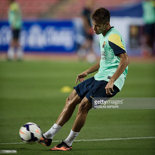 FC Barcelona football player Neymar kicks the ball during a training session at the Rajamangala football stadium in Bangkok on August 6 2013...