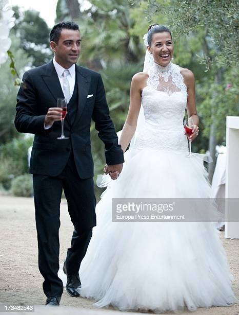 Barcelona football player Xavi Hernandez and Nuria Cunillera pose during their wedding at Marimurtra Botanical Gardens on July 13 2013 in Blanes Spain