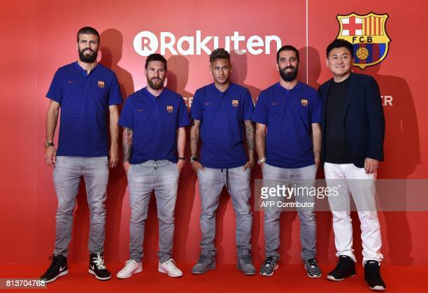 FC Barcelona football players Gerard Pique Lionel Messi Neymar Arda Turan and Rakuten CEO Hiroshi Mikitani pose for the media prior to a party in...