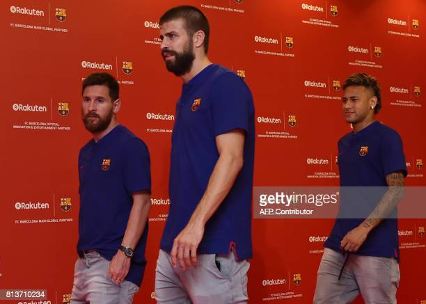 FC Barcelona football players Lionel Messi Gerard Pique and Neymar arrive at a party in Tokyo on July 13 2017 following their press conference to...