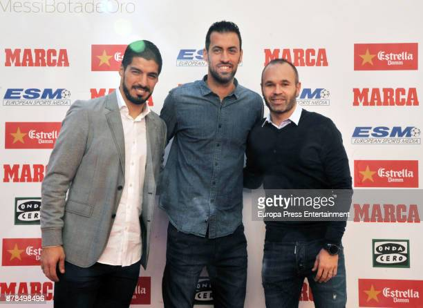 Barcelona football players Luis Suarez Sergio Busquets and Andres Iniesta attend the giving ceremony of the Golden Boot award to Lionel Messi at the...