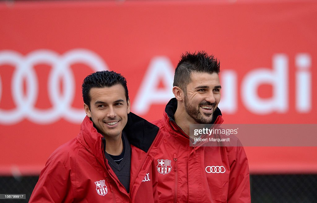 Barcelona football players Pedro Rodriguez and <a gi-track='captionPersonalityLinkClicked' href=/galleries/search?phrase=David+Villa&family=editorial&specificpeople=467566 ng-click='$event.stopPropagation()'>David Villa</a> (R) attend an Audi presentation during which Barcelona FC players received new Audi cars for the 2012-2013 season at Camp Nou on November 21, 2012 in Barcelona, Spain.