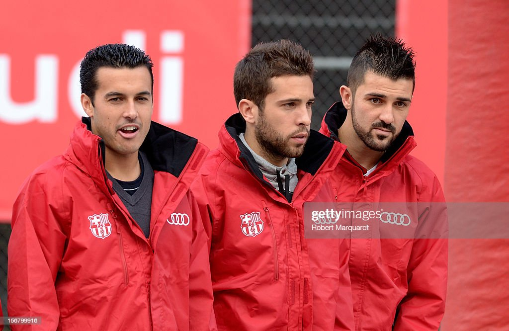 Barcelona football players (L-R) Pedro Rodriguez, <a gi-track='captionPersonalityLinkClicked' href=/galleries/search?phrase=Jordi+Alba&family=editorial&specificpeople=5437949 ng-click='$event.stopPropagation()'>Jordi Alba</a> and <a gi-track='captionPersonalityLinkClicked' href=/galleries/search?phrase=David+Villa&family=editorial&specificpeople=467566 ng-click='$event.stopPropagation()'>David Villa</a> (R) attend an Audi presentation during which Barcelona FC players received new Audi cars for the 2012-2013 season at Camp Nou on November 21, 2012 in Barcelona, Spain.