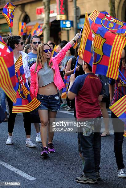 FC Barcelona football team's supporters celebrate in the streets of Barcelona on May 13 two days after their team won the Spanish league The Catalans...