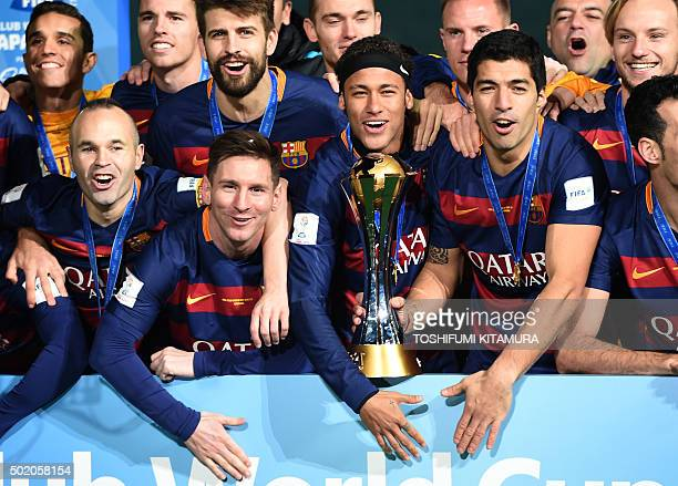 TOPSHOT Barcelona forward Andres Iniesta forward Lionel Messi forward Neymar and forward Luis Suarez celebrates with his teammates around the FIFA...