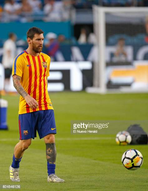 Barcelona forward Lionel Messi warms up before the start during of the ''El Clasico Miami'' BarcelonaReal Madrid match as part of the International...