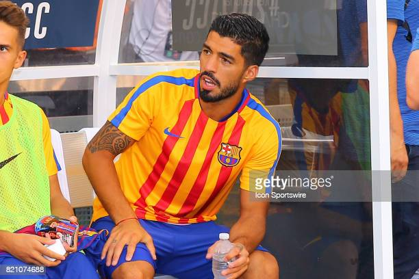 Barcelona forward Luis Suarez on the bench prior to the first half of the International Champions Cup soccer game between Barcelona and Juventus on...