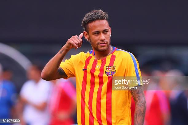 Barcelona forward Neymar gives a thumbs up to the fans during warm ups prior to the first half of the International Champions Cup soccer game between...