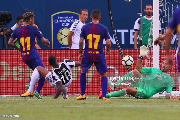 Barcelona forward Neymar shoots on Juventus goalkeeper Gianluigi Buffon during the first half of the International Champions Cup soccer game between...
