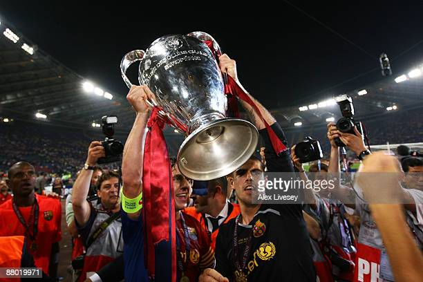 Barcelona goalkeeper Victor Valdes lifts the trophy together with his team mate Carles Puyol as they celebrate winning the UEFA Champions League...