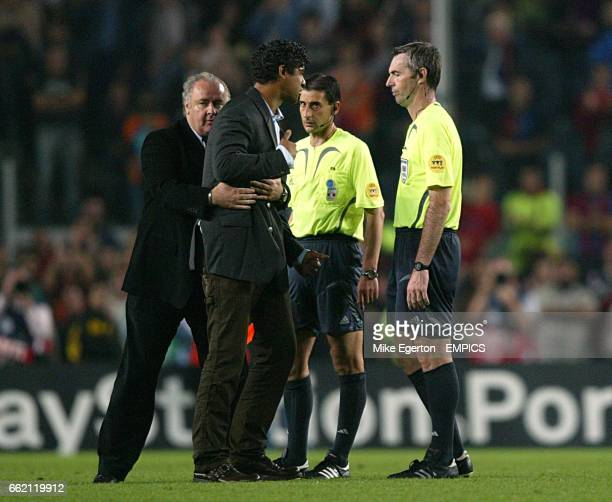 Barcelona manager Frank Rijkaard argues with referee Stefano Farina at final whistle