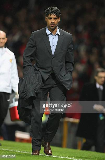 Barcelona Manager Frank Rijkaard heads for the dressing room at half time during the UEFA Champions League Semi Final second leg match between...