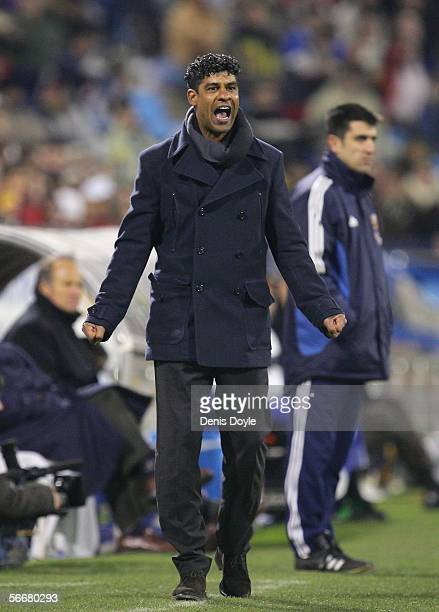 Barcelona manager Frank Rijkaard shouts at his team during a Copa del Rey quarter final first leg match between Real Zaragoza and FC Barcelona at the...