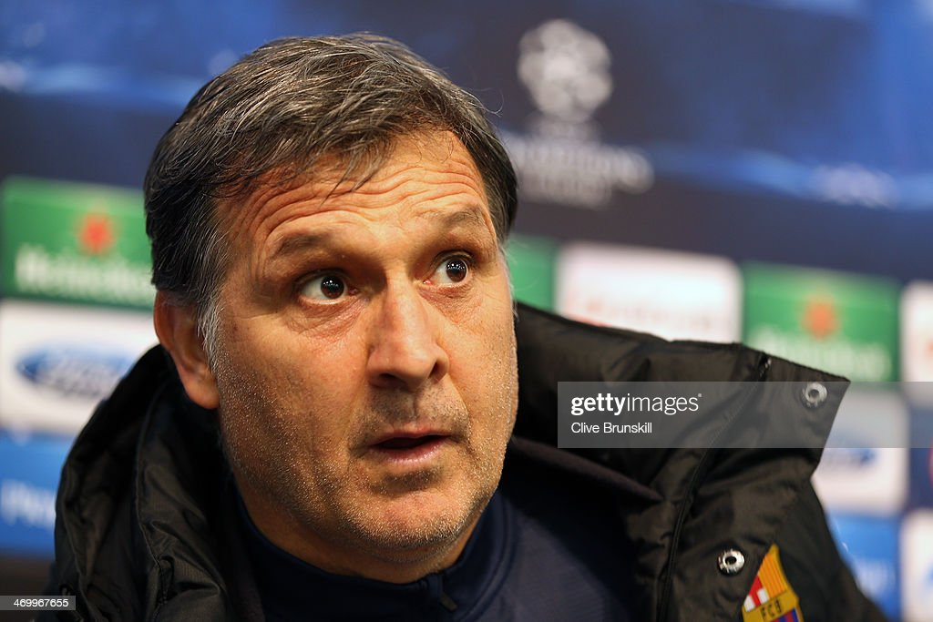 Barcelona manager Gerardo Martino arrives at a press conference prior to a training session ahead of their UEFA Champions League Round of 16 match 1st leg against Manchester City at Etihad Stadium on February 17, 2014 in Manchester, England.