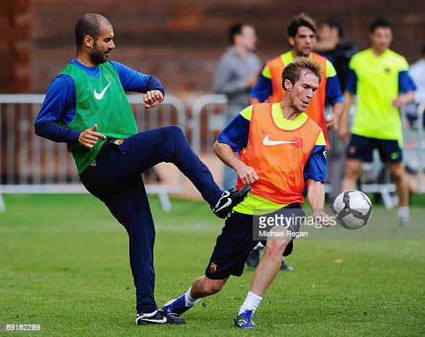 Barcelona manager Josep Guardiola is challenged by Alexander Hleb during an FC Barcelona training session at Bisham Abbey on July 22 2009 in Marlow...