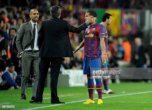 Barcelona manager Josep Guardiola looks on as Inter Milan manager Jose Mourinho talks to Daniel Alves of Barcelona during the UEFA Champions League...