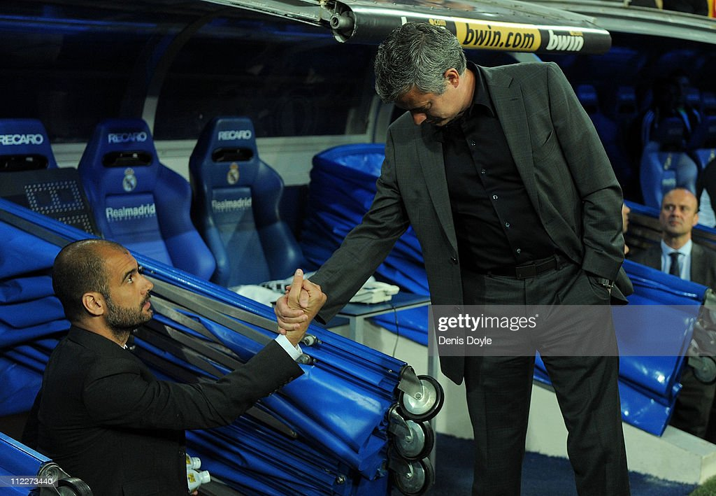 Barcelona manager (L) <a gi-track='captionPersonalityLinkClicked' href=/galleries/search?phrase=Josep+Guardiola&family=editorial&specificpeople=2088964 ng-click='$event.stopPropagation()'>Josep Guardiola</a> shakes hands with head coach Jose Mourinho of Real Madrid before the start of the La Liga match between Real Madrid and Barcelona at Estadio Santiago Bernabeu on April 16, 2011 in Madrid, Spain.