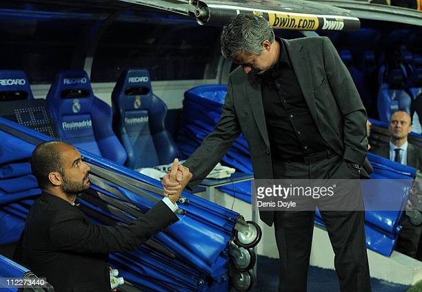 Barcelona manager Josep Guardiola shakes hands with head coach Jose Mourinho of Real Madrid before the start of the La Liga match between Real Madrid...