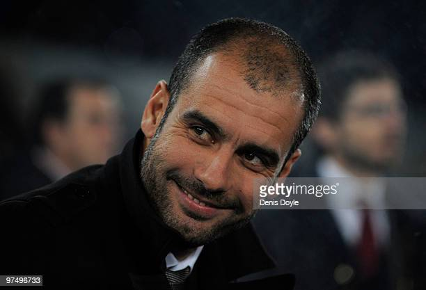 Barcelona manager Josep Guardiola smiles from the managers' dugout before the start of the the La Liga match between UD Almeria and Barcelona at...