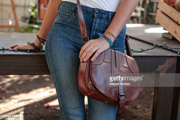 Cynthia poses wearing HM jeans and white tank top vintage hand bag Birkenstock sandals and Urban Outfitters bra at the Palo Alto Market on November 7...